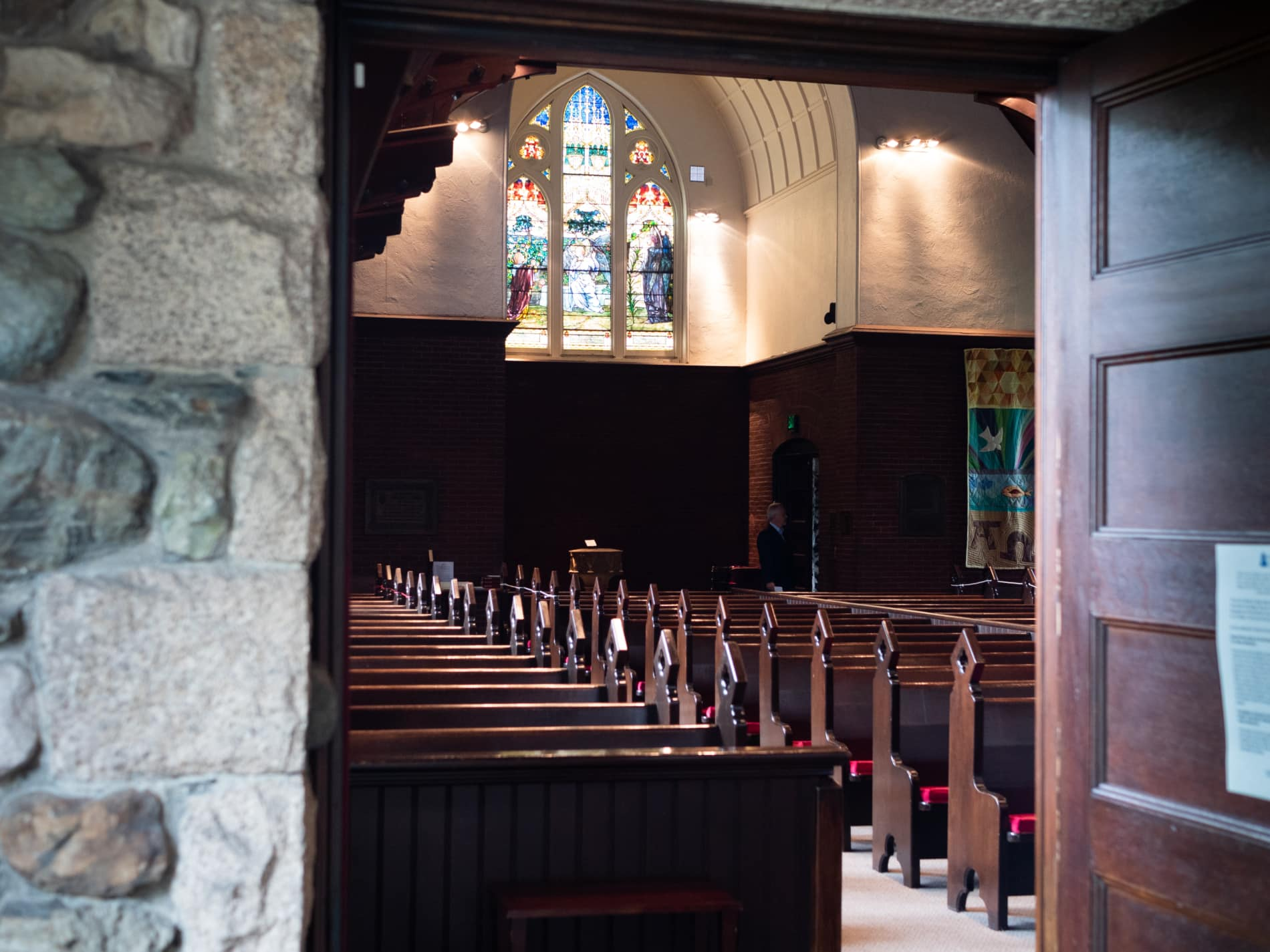A view from an open door into the sanctuary