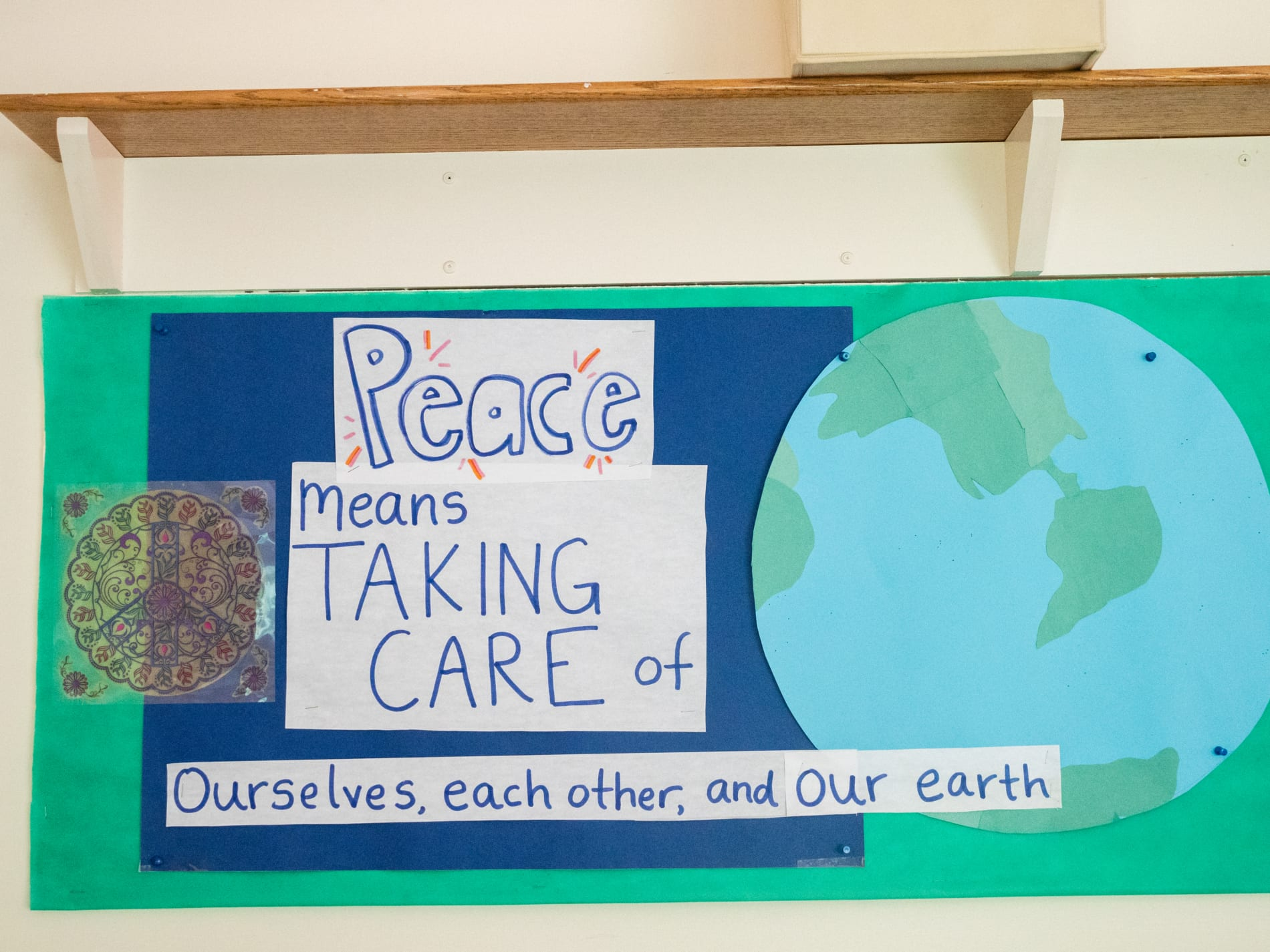 Poster with a picture of the earth that says