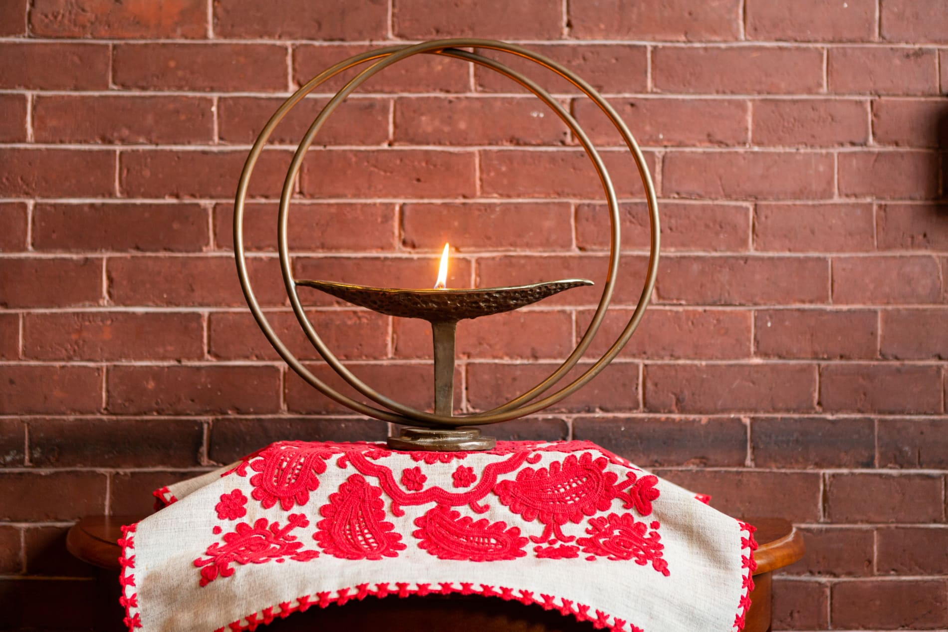 Our flaming chalice, on an altar cloth with traditional Hungarian embroidery.