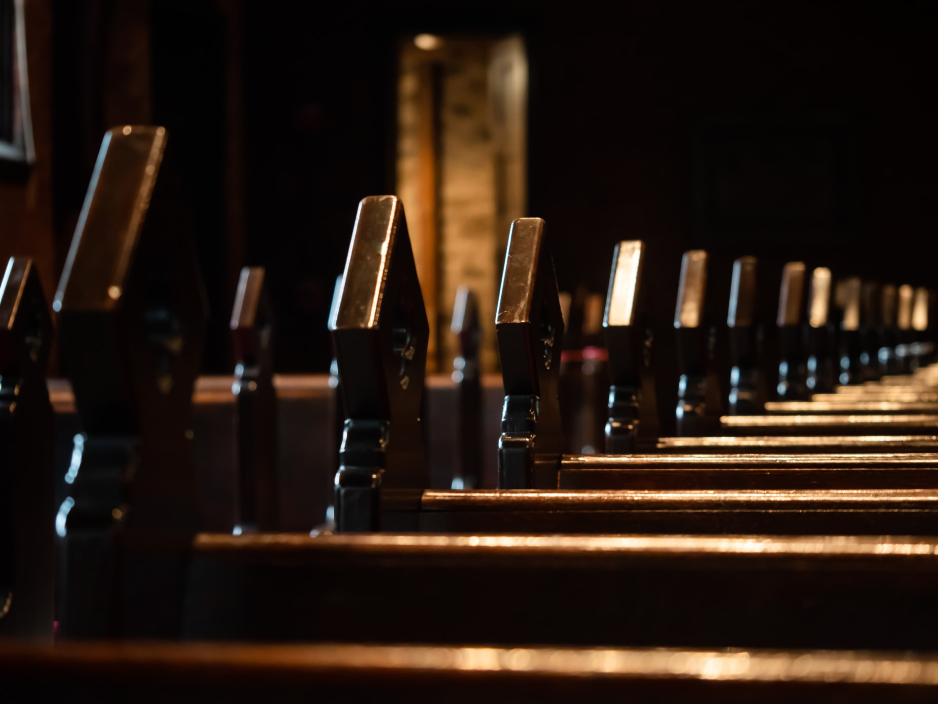 Wooden carved finials on church pews
