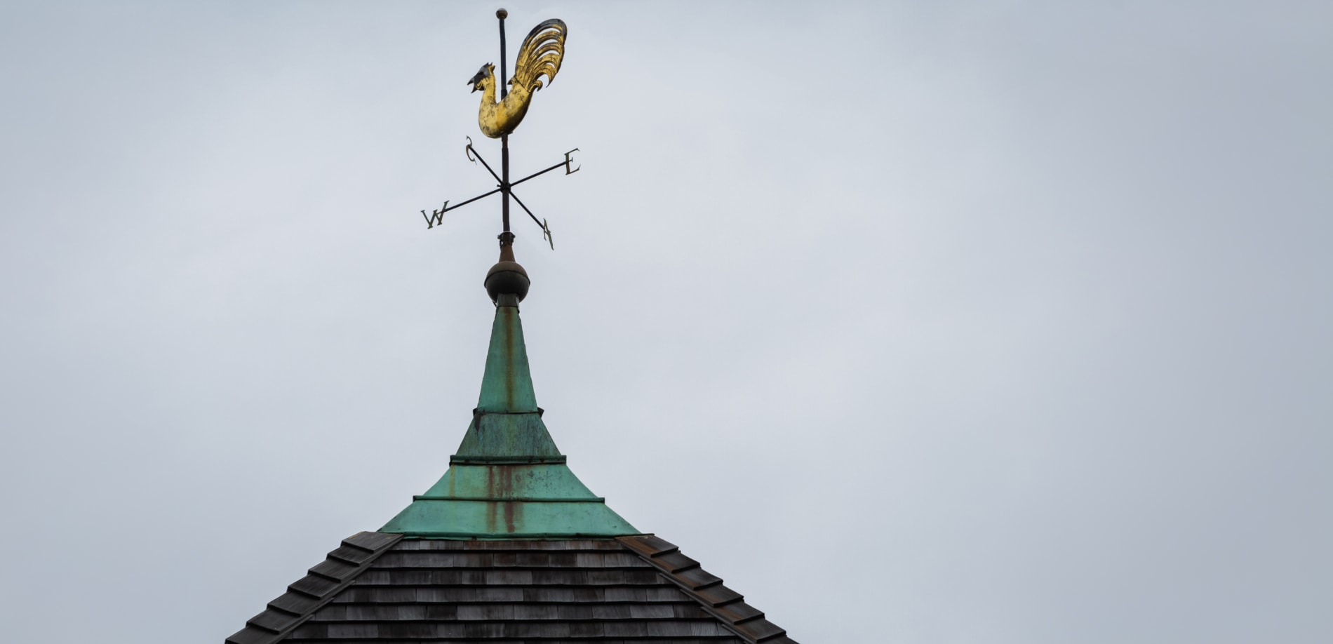 Tower with a rooster weathervane