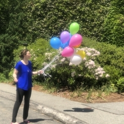 Rev. Napoline with Pride Sunday Balloons